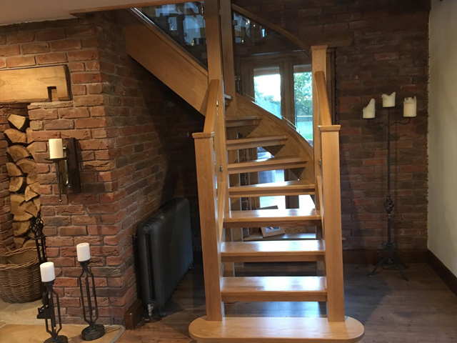 Wooden curved staircase from bottom